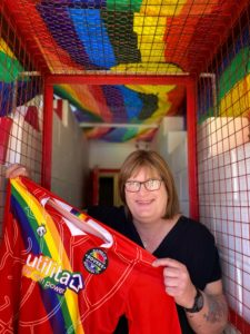 Sophie Cook in the tunnel at the Enclosed Ground, Whitehawk with the 2021 Rainbow Rovers Shirt