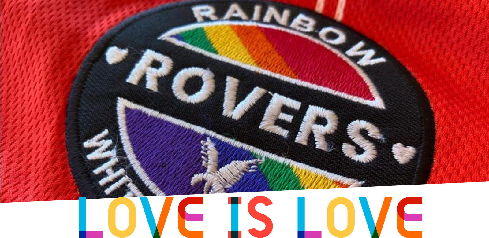 Close-up of the Rainbow Rovers crest on the 2021 shirt, with the tile 'Love is Love' below