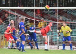 The teams in action - Rainbow Rovers vs Utilita Allstars - an acrobatic kick